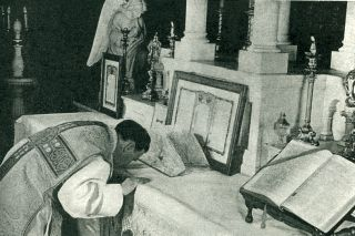 Priest Kisses the Altar