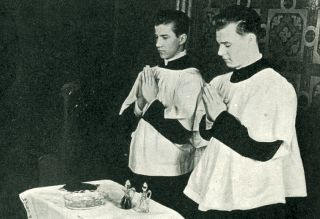 The Servers Assist the Priest with Water and Wine
