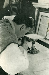 The Communion of the Body of Our Lord by Priest